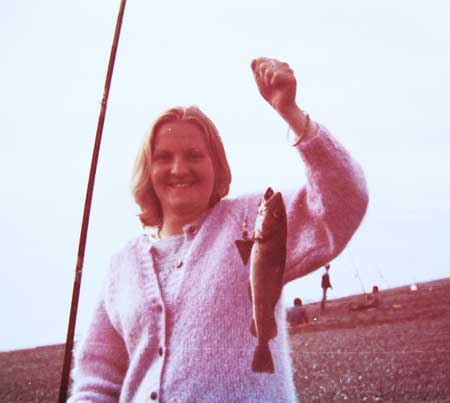 Mandy with a summer codling, south beach Greystones, Co. Wicklow, 1983.