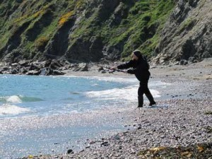 Davy casting a lure on that beach