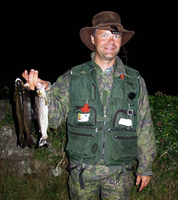 Kimo, with a fine catch of wild Roundwood trout.