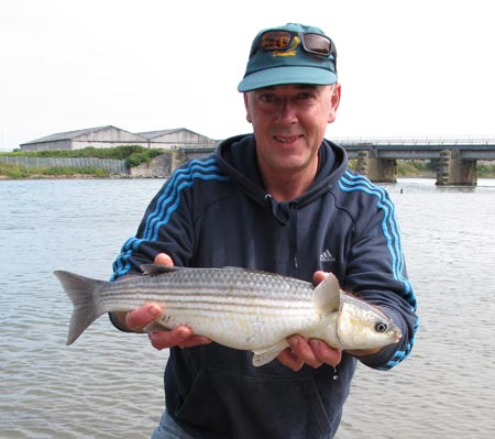Gerry Mitchell with a fine Vartry estuary mullet.