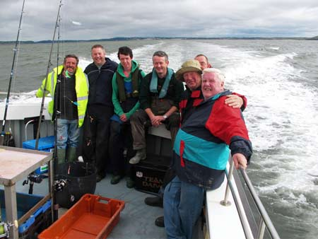 "A group of happy anglers on board the ""Wild Swan"" charter vessel."