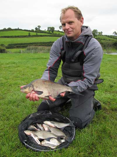 Trip organiser Christiaan Kooloos shows off his catch, Lough Muckno, Co. Monaghan, Ireland.