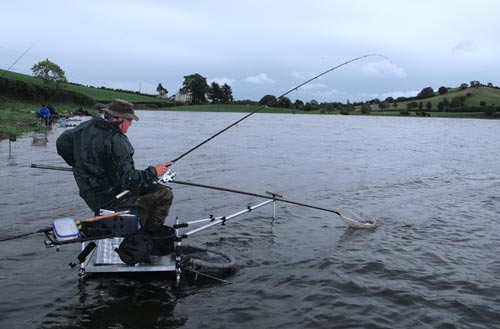Landing the catch, Lough Muckno, Co. Monaghan, Ireland.
