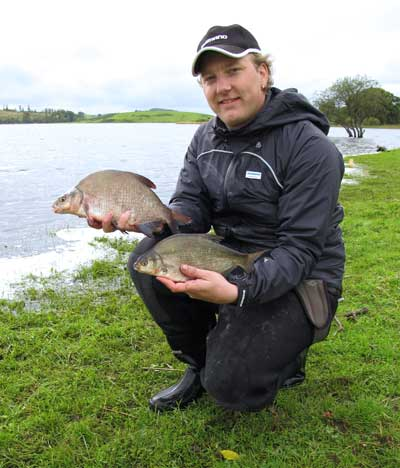 A happy angler with what looks like a bream and hybrid double, Lough Muckno, Co. Monaghan, Ireland.
