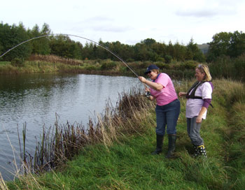 Playing a fish, Rathcon Trout Fishery, Co. Wicklow.