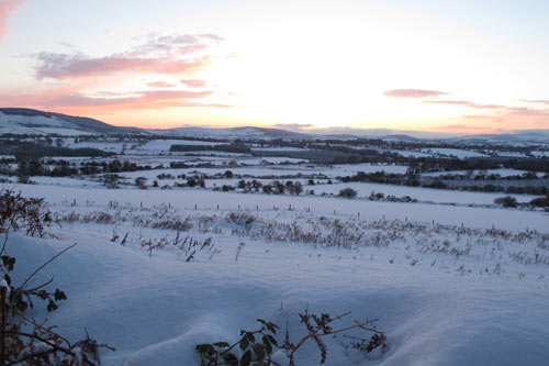 A snowy Ballythomas evening looking south west.