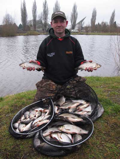 Carlow Coarse Angling Club chairman Gerry McStraw with 31.lbs of Athy marina, Co. Kildare, roach, dace, and hybrids.