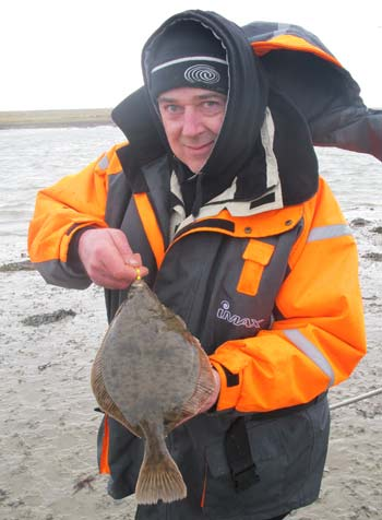Gerry Mitchell with the stamp of flounder common in south Wexford estuaries.