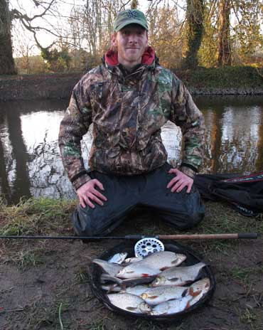 Gary Robinson with a bag of roach, silver bream, and hybrids from the River Barrow, Co. Kildare, Ireland.