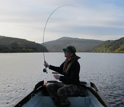 Casting a line, evening on Lough Dan, Co. Wicklow, Ireland.