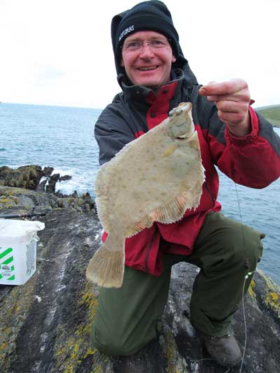 A pound dab tempted by lugworm while sea fishing on the Beara Peninsula, Ireland.