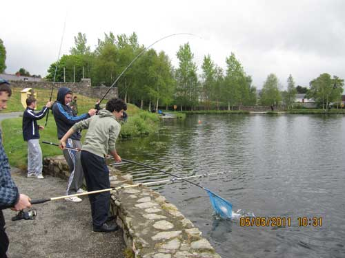 Landing a rainbow trout at the Angling for All facility, Aughrim, Co. Wicklow.