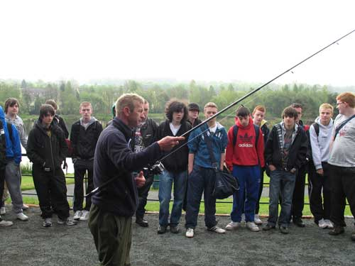 Des Chew of the DAI giving a fishing demonstration to transition year students of Templeogue College.
