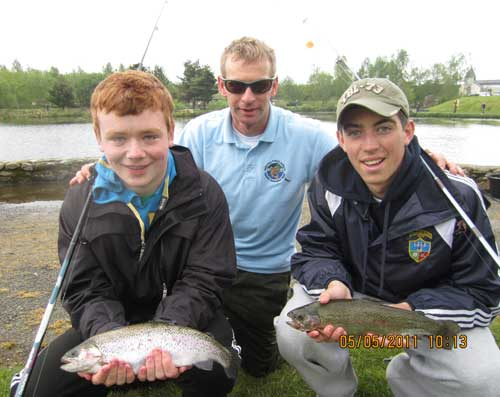 Craig Hendrick, Des Chew, and Owen Walsh show off their catch, Angling for All facility, Aughrim, Co. Wicklow.