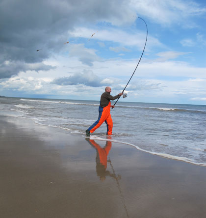 Ed Fahy surf casting on Ballinesker strand, Co. Wexford.