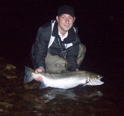 "Game angler and top fly dresser Denis O'Toole cradles a 16.lb Avoca Sea Trout tempted by one of his own creations, the ""Lava Tail""."