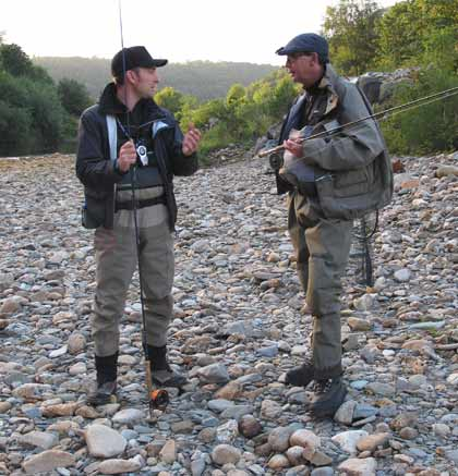 Chris McCully (on right) deep in conversation with Irish fly caught sea trout record holder Denis O'Toole.