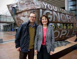 Celebrity chef Hugh Fearnley Whittingstall poses outside the EU parliament buildings in Brussels with EU Fisheries Commissioner Maria Damanaki.