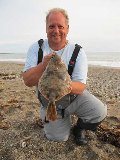 Dai Richards with a cracking beach caught Wexford flounder tempted by lugworm.
