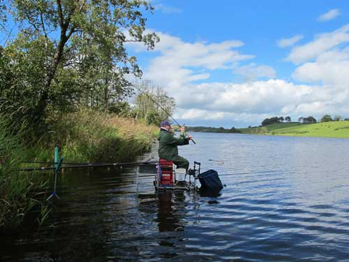 Casting the feeder while coarse fishing on Lough Muckno, Co. Monaghan, Ireland.