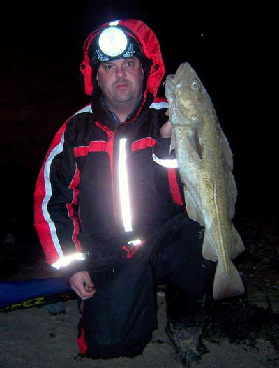 Frank Flanagan of the Menapia SAC, Wexford, Ireland holds up a cracking 8.lb beach caught cod.