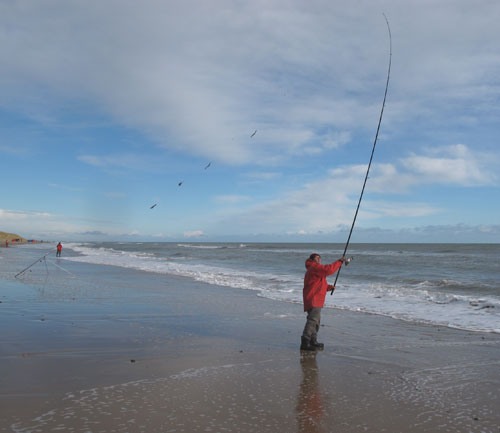 Welsh angler Shane Tucker casting on Ballinoulart strand, Co. Wexford.