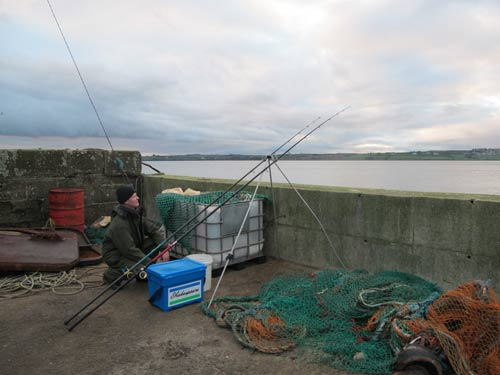 Pier fishing on the Waterford estuary, Ireland.