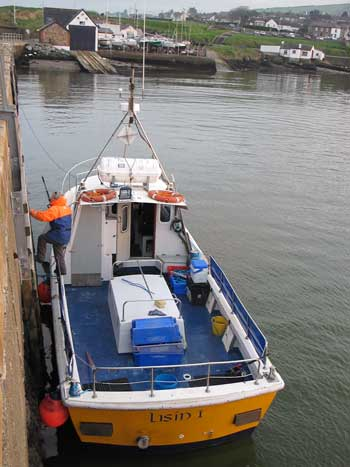 Stern view of Wicklow Boat Charters deep sea angling vessel LISIN 1, moored at Wicklow harbour, Ireland.