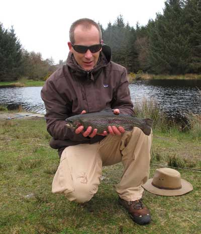 Rob Love with one of six Annamoe rainbows lured to his rod.