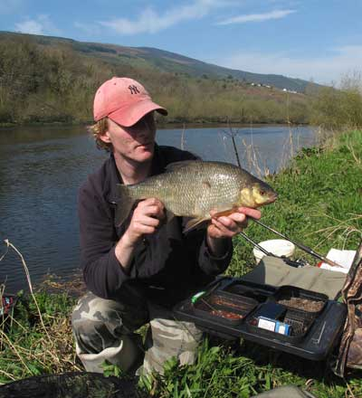 Gary Robinson with one of three Barrow bream on a sunny spring day.