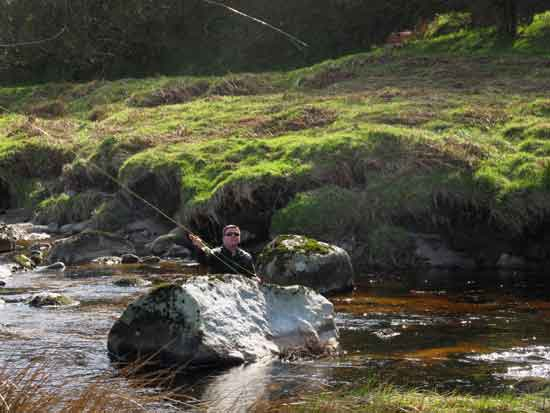 Using cover, fly fishing in Co. Wicklow, Ireland.