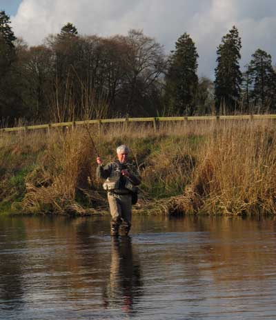 Liam Stenson (Irish Fly Fisher) fishing down stream wet on the River Liffey, Co. Kildare, Ireland.