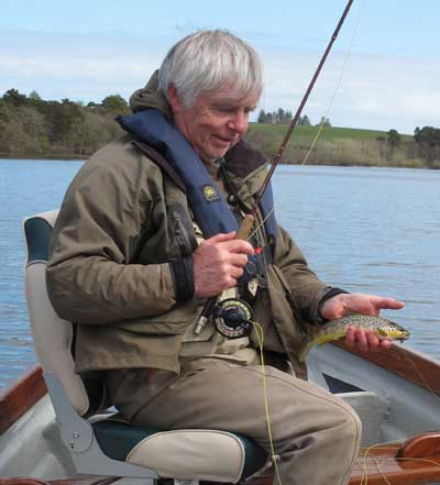 Irish Fly Fisher, Liam Stenson cradles a Roundwood brownie.