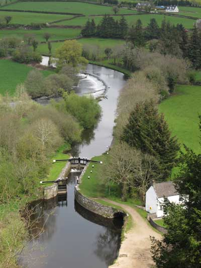 The River Barrow flows over Clashganny weir below Borris, Co. Carlow, Ireland.
