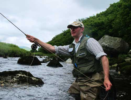 Downstream wet fly fishing on a Wicklow mountain stream, southern Ireland.