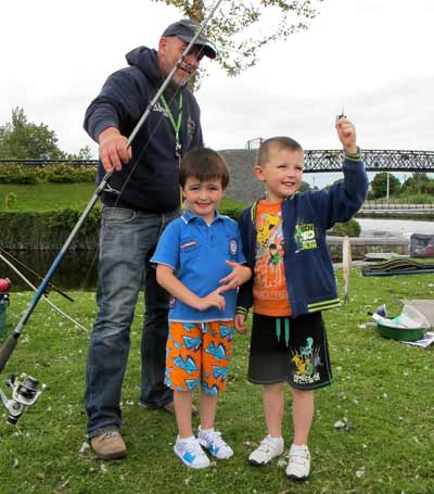 Ian Warburton with two happy chaps displaying their first fish in Carlow Town Park.