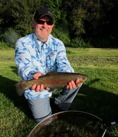 Indiana state visitor Troy Owen displays a fine Annamoe rainbow tempted by a peach booby.