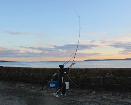 Pier fishing on a crisp, frosty, October evening, Co. Wexford, Ireland.