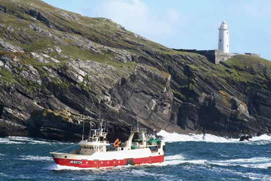 Running for shelter, an off shore trawler returning to Castletownbere, Co. Cork, Ireland.