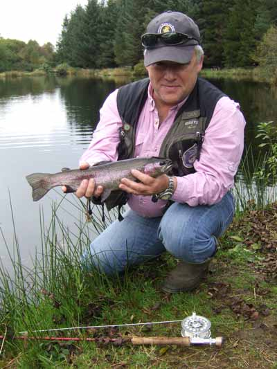 Mark Corps, Game Angling Advisor with Inland Fisheries Ireland, sports a fine Annamoe rainbow.