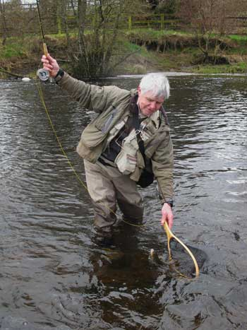 Irish Fly Fisher Liam Stenson nets a nice River Liffey Brownie.