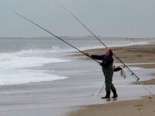 Gerry Mitchell surf casting on a south Wexford strand.