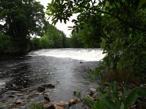 Weir pool on the Aughrim River, Co. Wicklow, Ireland.