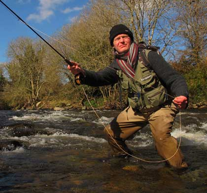 Spring fly fishing for wild brown trout on the Avonmore River County Wicklow, Ireland.