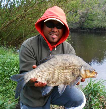 Alastair Leong proudly displays a 4.lb 11.oz River Barrow bream.