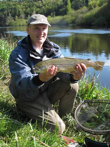 Duncan Cole with a 4.lb wild River Barrow brown trout caught and released.