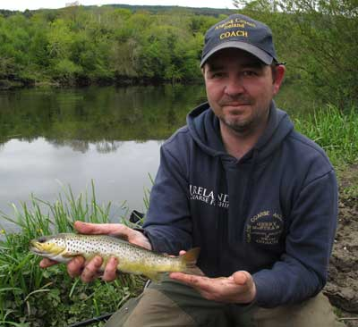 Carlow Coarse Angling Club Chairman Gerry McStraw displays a nice wee trout.