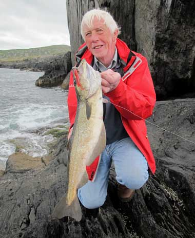 United Kingdom visitor Keith Kendall sports a grand jelly worm tempted pollack.
