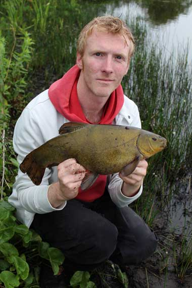 A four pound six ounce tench for Gary Robinson.