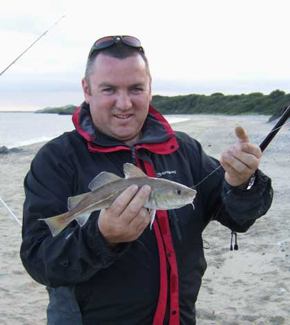 Aidan Walsh with a summer codling caught on lugworm.